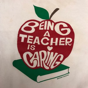 Fruit of the loom 50/50 sweatshirt ' Being a teacher is caring ' (100)